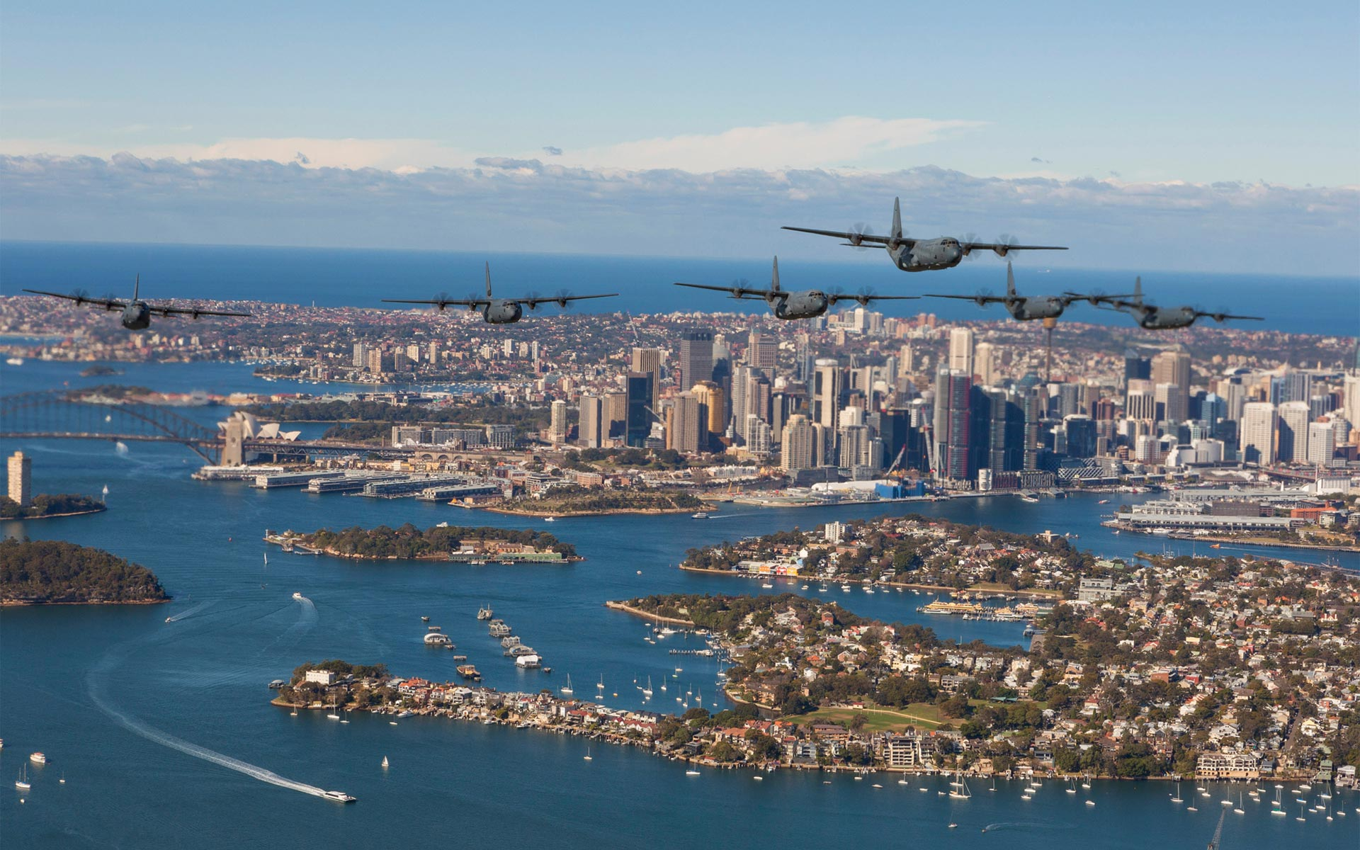 Military transport aircraft flying over Sydney