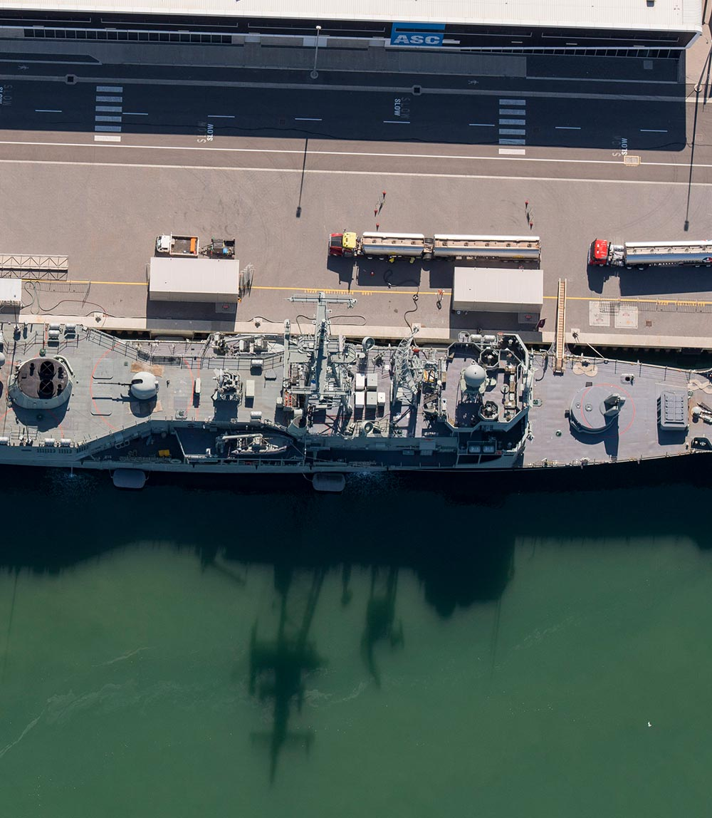 Aerial shot of a navy ship docked at ASC