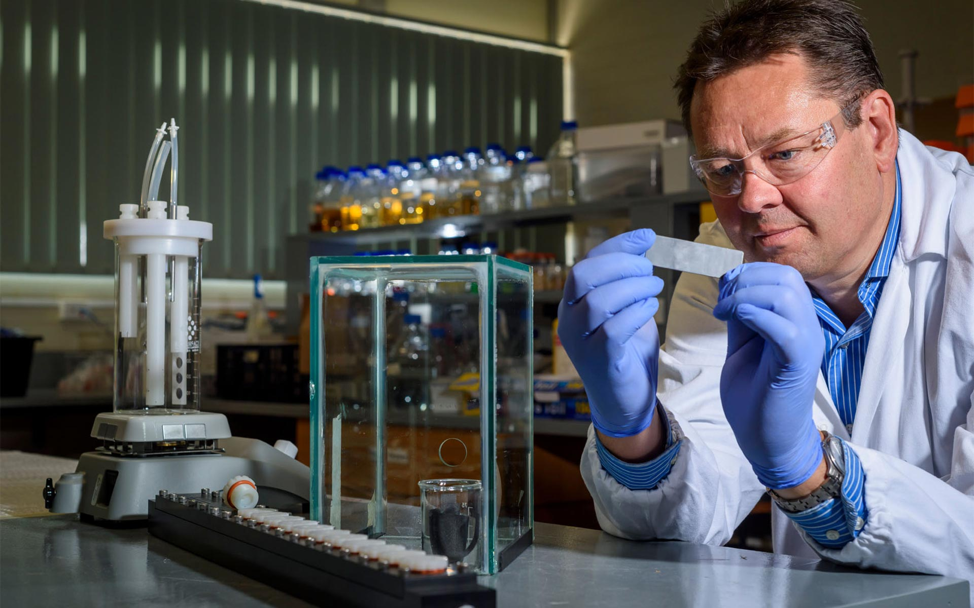 Scientist working to develop an active marine coating